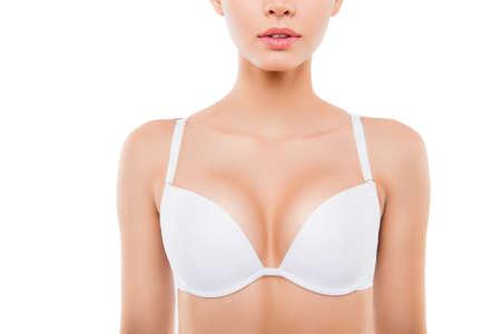 Sluit omhoog van sexy vrouw met perfecte borst in witte bustehouder Stockfoto