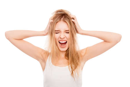 Frustrated young pretty blonde with damaged hair screaming Stock Photo