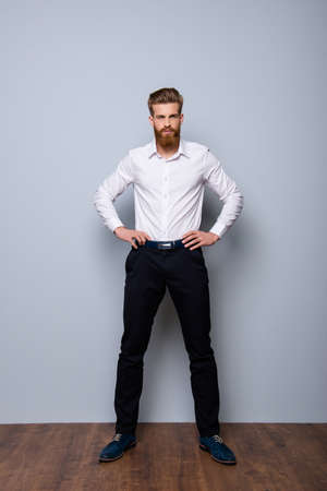 Full-length portrait of serious confident  bearded man in formalwear