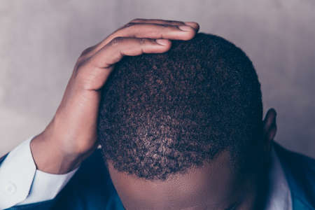 Close up  cropped portrait of successful  handsome afroamerican man in stylish suit touching his hair