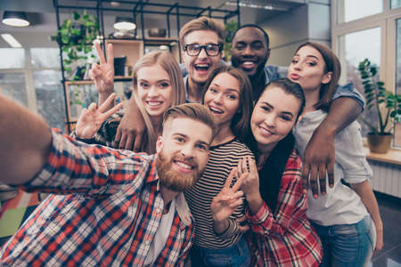 Group of happy cheerful best friends making selfie Stock Photo