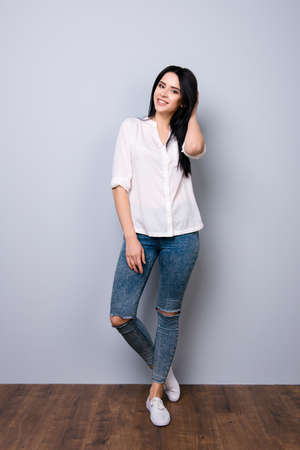 full-length portrait of cute stylish young woman posing Stock Photo