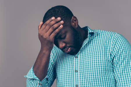 Portrait of bearded   afroamerican man touch head. He have strong migraine Reklamní fotografie - 77565208