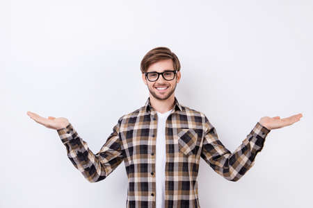 Happy smart young worker in glasses making presentation of two different options