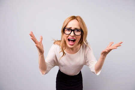 Nervous angry businesswoman shouting on the screen Stock Photo - 78699889
