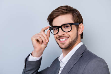 Close up portrait of cheerful succesful male in glasses with stunning smile Stock Photo