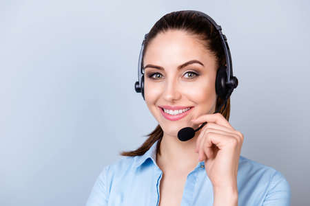 Close up portrait of smiling consultant of call center in headphones isolated on gray background Stock fotó - 80694357