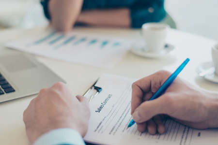 accommodation broker: Close up photo of mans hands signing a contract Stock Photo