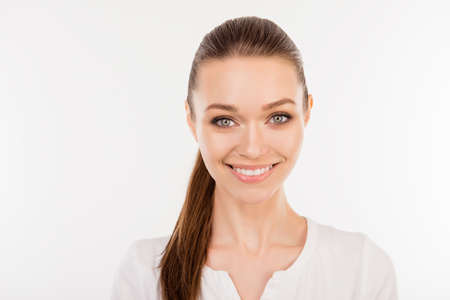 Close up portrait of pretty young smiling woman with ponytail isolated on white background