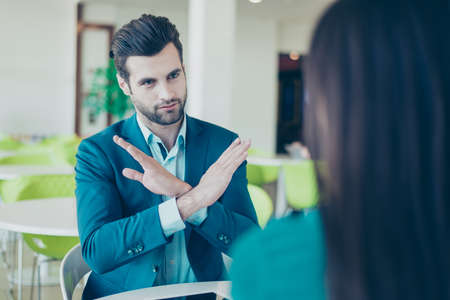Meeting of two businesspeople. No. Young businessman  doesn't want to invest money