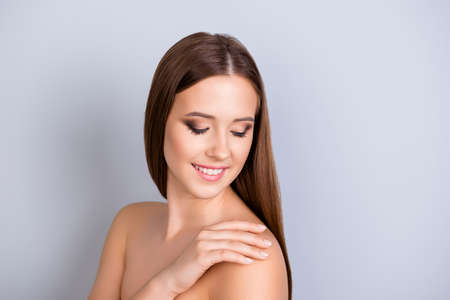 Beauty and health, dermatology concept. Cose up cropped photo of pretty young girl touching her skin and look so fresh, healthy and attractive Stok Fotoğraf
