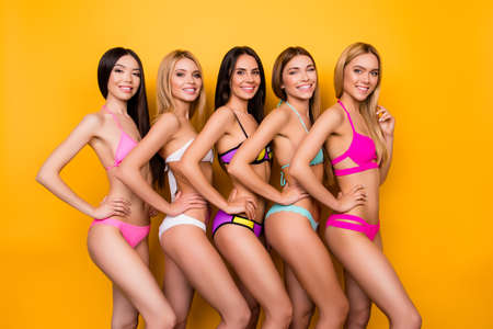 Model show, miss beauty contest concept. Diversity of five young attractive ladies, different ethnicity, posing in fancy trendy, fashionable bikinies. So perfect, ideal, healthy bodies