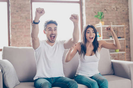 Winners! Friends are fans of sports games as football, basketball, hockey, baseball, love spending their free time at home together. They are screaming and gesturing for a victory