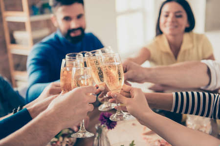 Close up photo of glasses with champagne. Young people are toasting to celebrate the event together Stock Photo