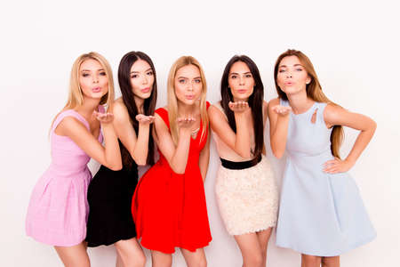 Five young coquettes are posing for photo, all in colorful short cocktail dresses