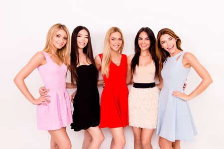 Five cute ladies in colorful short cocktail dresses are ready for night out party Stock Photo