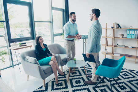 Happy young married couple is back together after visiting the psychologist and working hard for relationships, nice design of his office interior Stock Photo