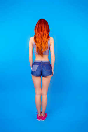 Full-length photo of rear view of foxy pretty slim girl in short shorts
