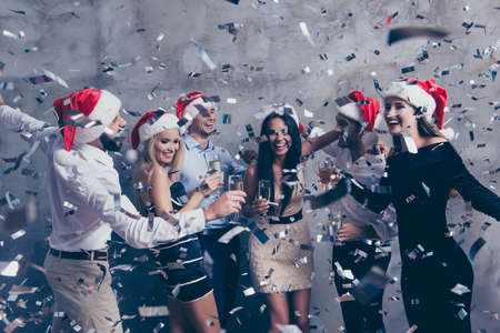 Newyear celebration,Group of beautiful festive youth scream.