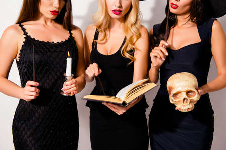 Cropped shot of three hot sorceress supersition spiritualists, practising occultism, with skeleton head, diabolic, satanic, devil, hex, wiccan exorcist paranormal ritual, dark spirits culture