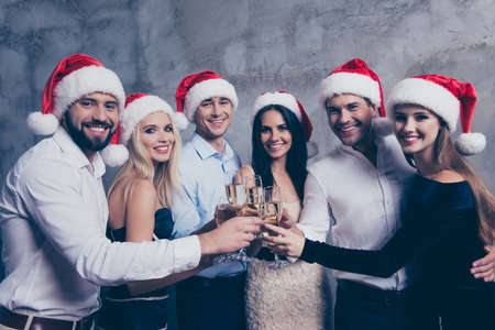 Three festive couples of lovers with stemware of martini on luxury feast, love is in air, they embrace, relax. Stock Photo