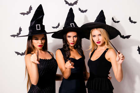Dark spirits culture. Diabolic, satanic, devil, hex, wiccan exorcist paranormal ritual. Three hot sorceress supersition spiritualists are practising occultism, white background with bats Stock Photo