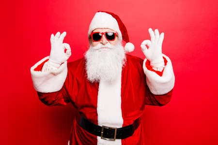Playful cool funny naughty tourist santa grandfather is showing accept signs, fooling around, in trendy specs, so confident