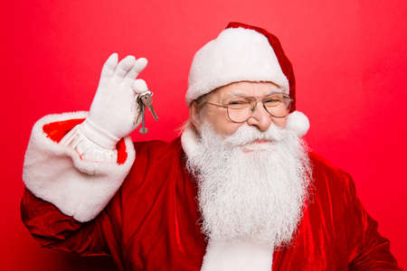 Funny grandfather in red Santa Claus traditional outfit.