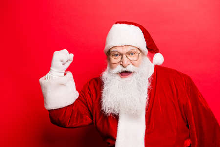 Cool funny playful naughty Santa Calus grandfather fooling around