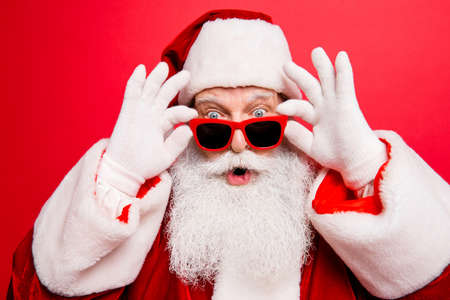 Cool funny playful naughty Santa Claus grandfather fooling around Imagens - 87597849