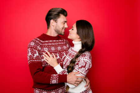 cute guy: Portrait of adorable sweet family hugging and look into eyes of each other with such love and care, grin, in knitted cute traditional x mas wear with ornament, lady has braided  brunette hair