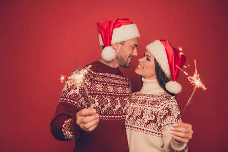 X mas miracle, holy spirit! True feelings! Adorable, lovely, sensual cute friends in knitted cute traditional x mas costumes with ornament are hugging and want to kiss, winter, noel