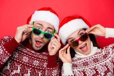 Omg! Increadible unbelievable crazy december discount on trips! Travel time! Holly jolly x mas! Closeup of excited astonished tourists with wide open eyes, mouthes, adjusting eye wear, noel costumes