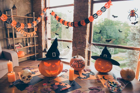 Preparation for halloween, cutted pumpkin, fall leaves, spiders nets, headwear of witch, bowl with candies on top of wooden table. Ready for feast in mystery interior. Concept of all hallows eve Stock fotó - 87790894