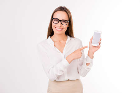 Look! Successful gorgeous feminine successful intelligent stunning intelligent stylish adult brown haired entrepreneur leader expert is presenting new smartphone, so trendy! Roaming service Stock Photo
