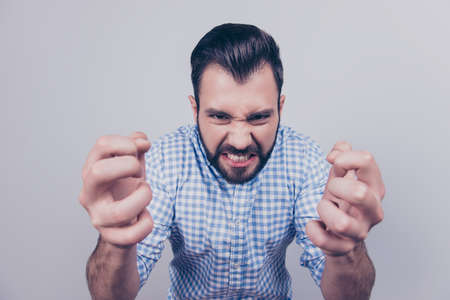 Close up portrait of brunet bearded entrepreneur in smart casual white and blue checkered shirt, on the pure light blue background, wanting to kill or kick someone, very upset, frustrated Stok Fotoğraf - 88196082