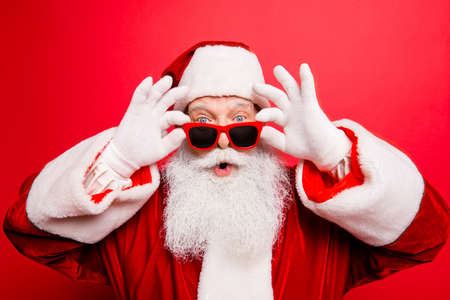 Holly jolly x mas noel! Increadible unbelievable crazy december surprise travel trips time omg! Closeup of aged excited astonished tourist santa with wide open eyes, mouth, adjusting eye wear Stock Photo