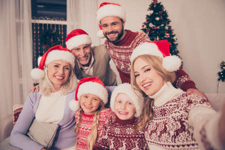 granny and grandad: Portrait of six cheerful multi generation relatives bonding on couch, married couple, excited siblings, grandad, granny, in traditional x mas costumes, pine firtree, home, happiness, love