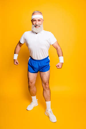 Full length of cheerful excited mature modern macho goofy cool competetive pensioner leader grandpa champion practising bodybuilding. Body care, strength, leadership, motivation lifestyle