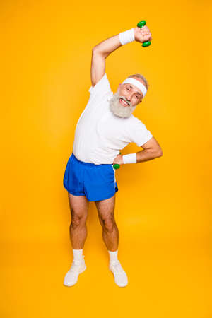 Full length of cheerful emotional cool grandpa with humor grimace exercising holding equipment Stock Photo