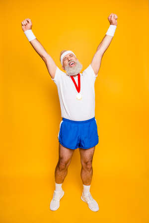 Full length of best successful motivated insane active modern cool funny grandpa celebrating. Body, health, care, lifestyle, game, challenge, champ, hero, leisure, training, workout Standard-Bild