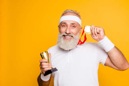 Close up portrait of crazy comic emotional cool grandpa holding precious reward. Body, health, care, lifestyle, game, challenge, champ, hero, leisure, training, workout, strength, power Stok Fotoğraf - 88218113