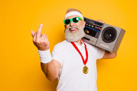 Crazy aged rude sporty funny sexy athlete grandpa in eyewear with recorder. Old school, swag, fooling around, gym, workout, technology, groove, stereo sound, funky leisure, chill, young Stock Photo - 88218125