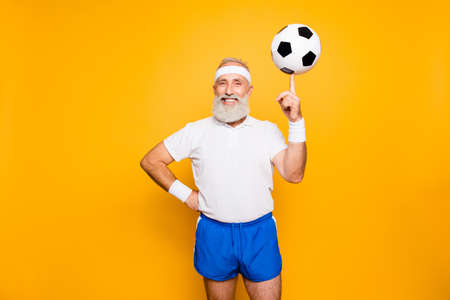Cool funny modern competetive pensioner, leader, champion plays with ball