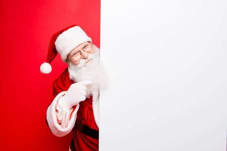 christmastime: Advertisement, discounts, presents gifts selling december, winter tradition wish, eve, celebration of christmastime concept. Santa is standing near the white blank banner and points at side, empty