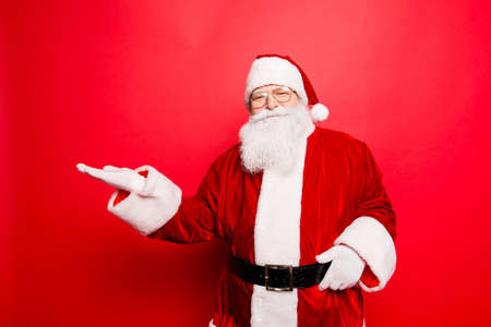 Sales, marketing, discounts, advertising, presents, gifts selling time! Holly jolly x mas is soon! Be ready, prepare! Saint nicholas is showing on side with arm, isolated on red background