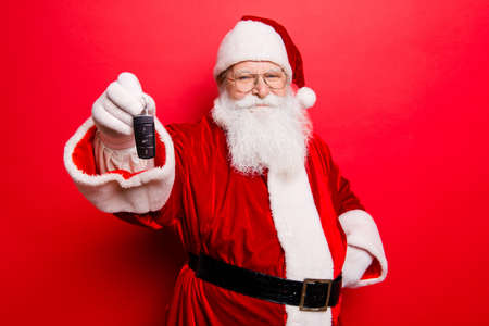 Funny aged grandfather in red traditional outfit and headwear. X mas noel time! Success, happiness, surprise, dream, december, buyer, ownership, property, purchase, rent, sell, cars concept