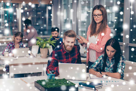 Business manager checking financial task of her colleagues. Snowflakes,winter background Stock Photo