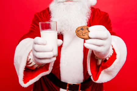 Close up cropped of relaxed serene santa in costume, white gloves going to have a pause with tasty treats, beverage, dream, december time. Holly jolly x mas festive noel!