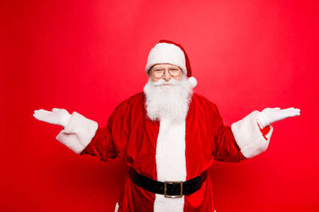 choise: Santa is gesturing with hands like he is holding something and need to choose between two options